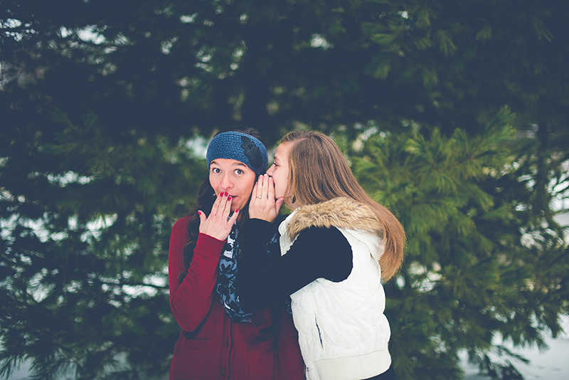 two-girls-sharing-secrets