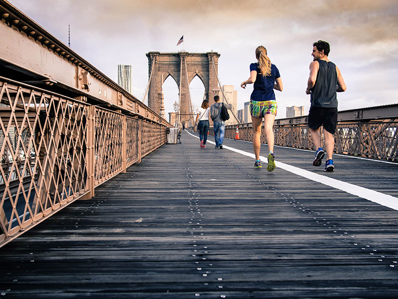 man-and-woman-running-on-brooklyn-bridge