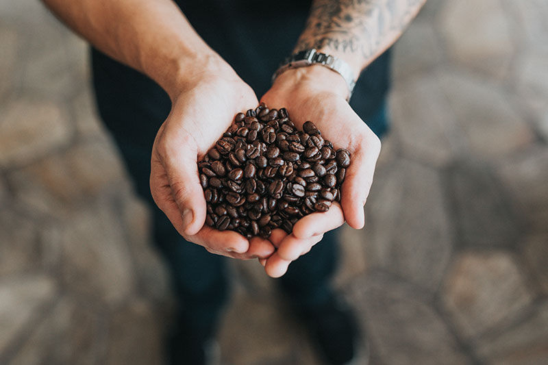 man-holding-coffee-beans